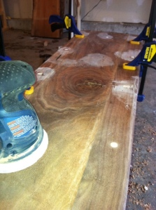 Sanding down the pegs that hold the top in place
