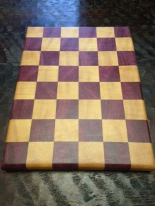 """This 1"""" thick end-grain cutting board made from Purpleheart and Pau Amarello will easily last a lifetime with very minimal care."""