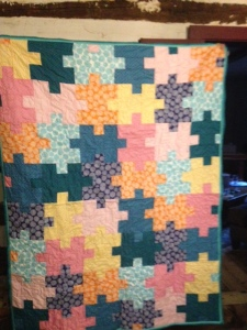 This a new crazy awesome handmade puzzle  quilt from the Frydog Stitch shop.  (Value 200$)